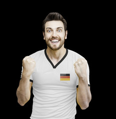 German soccer player celebrates on black background