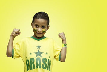 Brazilian fan celebrate on yellow background