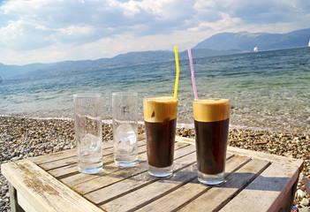 espresso  cold coffee - sea beach