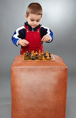 Kid learning to play chess