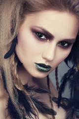 Woman with creative makeup and hairstyle