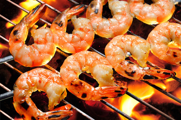 Grilled shrimps on the flaming grill