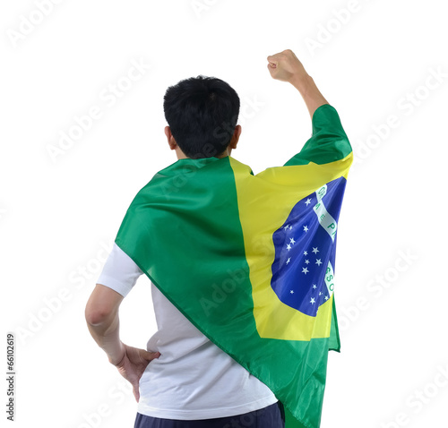 Brazilian man celebrates with flag and mask
