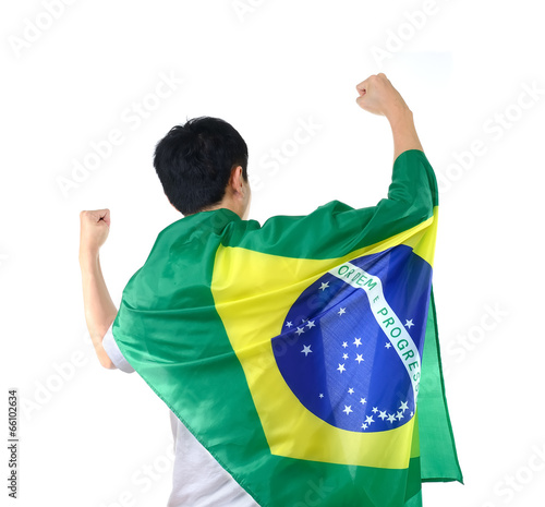 Brazilian man celebrates with flag and mask