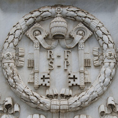 Vatican shield carved in stone in the Vatican City