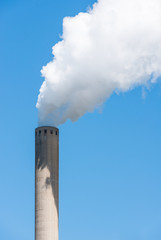 Grey chimney with white smoke