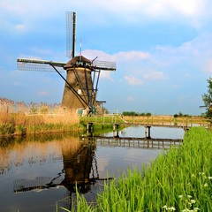 Dutch windmill with canal reflections at Kinderdijk, Netherlands