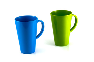 Green and blue cup isolate on white background