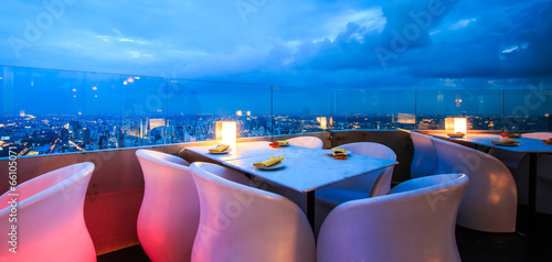 Dinner with romantic scene at the high building