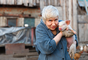 woman holding a small pig