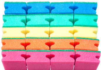 Background of colorful sponges isolated