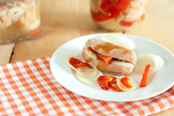 traditional czech pickled sausages with onion and red pepper