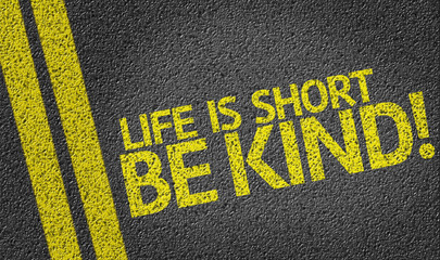 Life is Short Be Kind written on the road