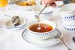 Leinwandbild Motiv Sahne im Tee