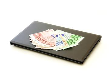 Euro on laptop on a white background