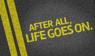 After All, Life Goes On written on the road