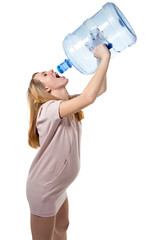Pregnant woman drinking from bottle