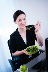 cheerful young business woman fresh salad lunch break office