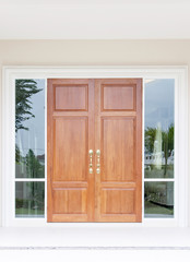 Double wooden doors with glass and frame
