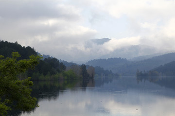 Foggy landscape with water reflection