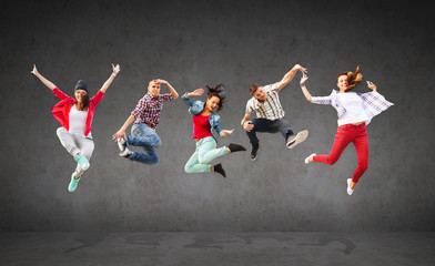 group of teenagers jumping