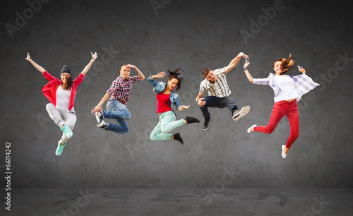 group of teenagers jumping - 66114242