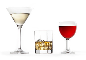 three glasses of various drinks