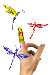 Flock of painted dragonflies flying around finger