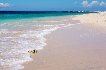 Soft wave of the sea on the sandy beach with coral, Gili Meno, I