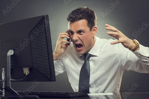 Angry businessman shouting on phone - 66116445