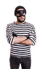 Angry thief with mask isolated on white background