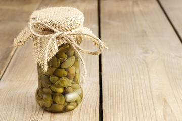 Pickled capers in glass jar, copy space