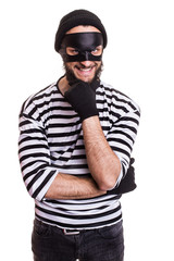 Crafty robber smiling and thinking