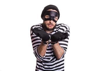 Sad criminal with handcuffs