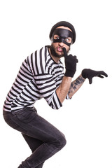 A thief with mask quietly slinking