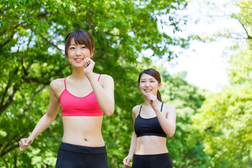 young asian women jogging in the park