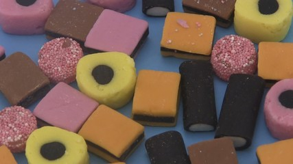 Liquorice allsorts on a blue background.