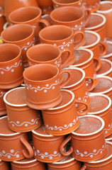 Hand made clay tea cups background