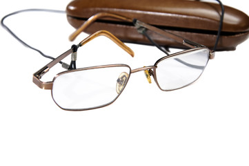 Close-up of eyeglasses next to its case