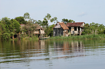 Houses on stilts rise above the polluted water in Belen, Iquitos