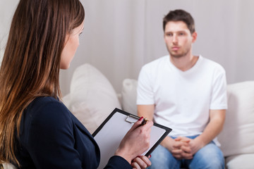Young man during psychotherapy