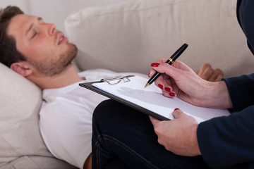 Man resting at psychotherapist room