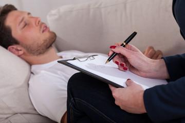 Man resting at psychotherapist room