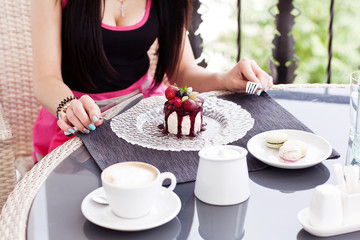 Woman Eating Cake In Coffee Shop