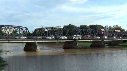 Time lapse of Iron Bridge across Ping river.