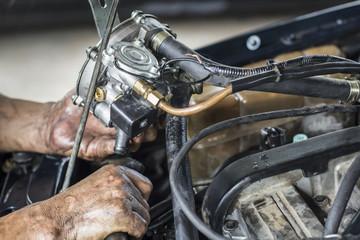 Mechanic install new car gas vaporizer in old car , bi-fuel