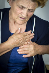 Senior oman having chest pain