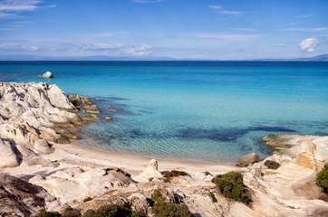 Little sandy beach the rocks, in Sithonia, Chalkidiki, Greece