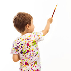 Little boy with a paintbrush, rear view