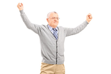 Mature man raising his hands out of joy